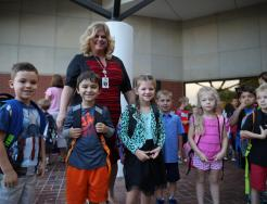 Principal Twibell with students