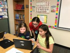 5th gr. students working to create math programs for 4th gr. students